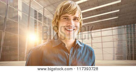 Portrait of smiling hipster businessman against modern room overlooking city