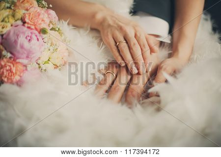 Wedding Bouquet Closeup In Front Of Couple