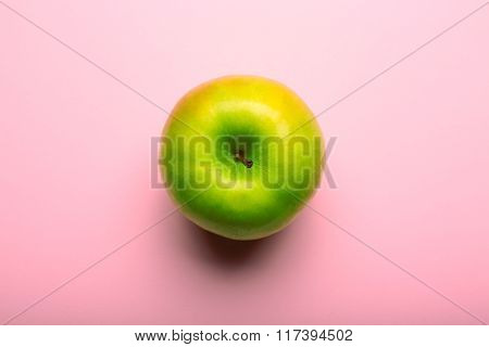 Whole Green Apple On Pink Background, Close Up