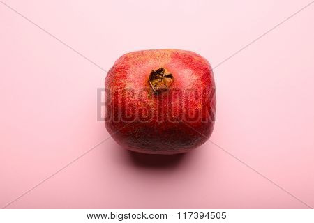Whole Pomegranate On Pink Background