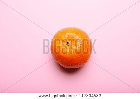 One Tangerine On Pink Background