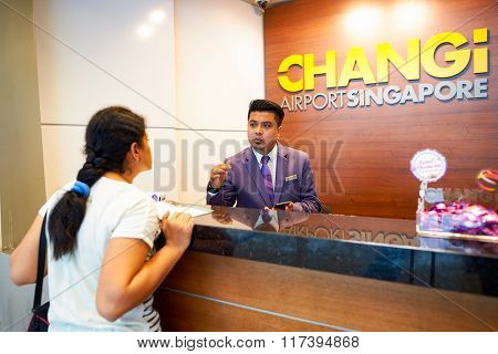 SINGAPORE - NOVEMBER 09, 2015: staff at Changi airport. Singapore Changi Airport, is the primary civilian airport for Singapore, and one of the largest transportation hubs in Southeast Asia