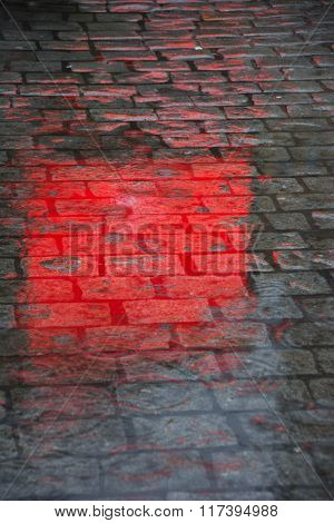 Reflection on the cobblestones in a street