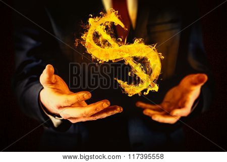Midsection of businessman with arms out against dark background