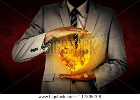 Handsome businessman gesturing with hands against dark background Handsome businessman gesturing with hands on a white background