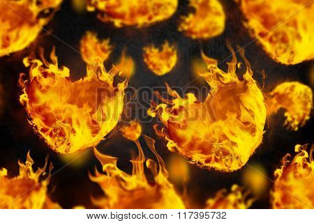 Heart shapes on fire against black
