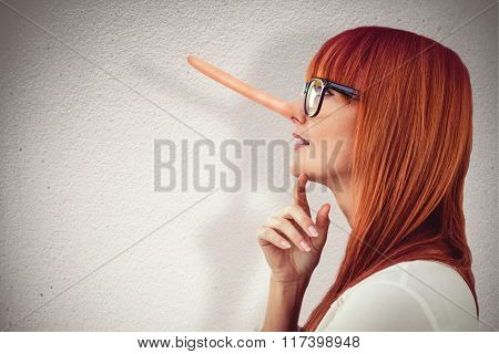 Attractive hipster woman looking at sticky notes against grey wall