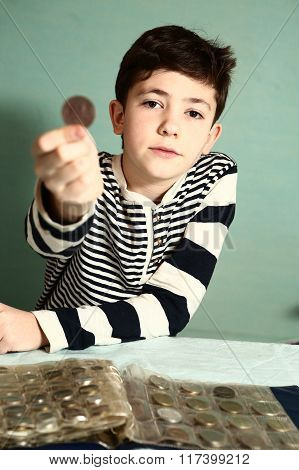 boy preteen numismatic collector show his coin collection