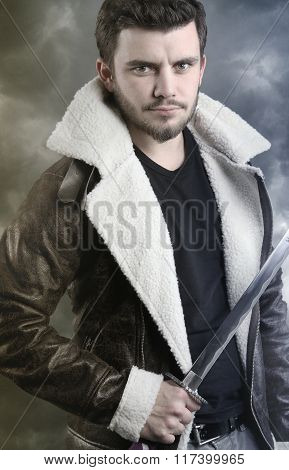 fictional character - young man holding a saber