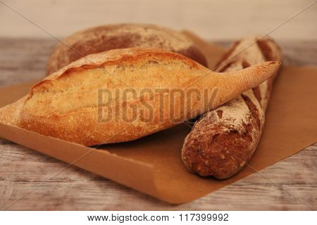 Different breads on wooden table. Food background