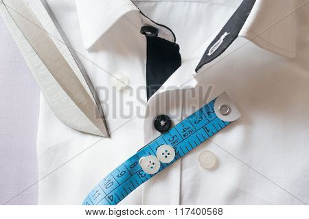 High key white shirt with measuring tape