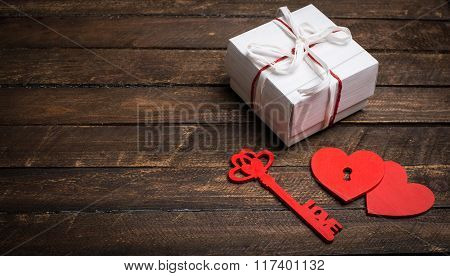 Vintage Card With Red Hearts, Key And Gift Box On Old Wood. Valentines Day Background. Key Of My Hea