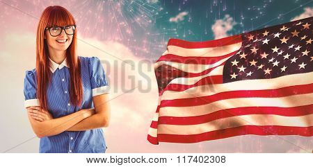 Composite image of gorgeous smiling red haired hipster beside american flag