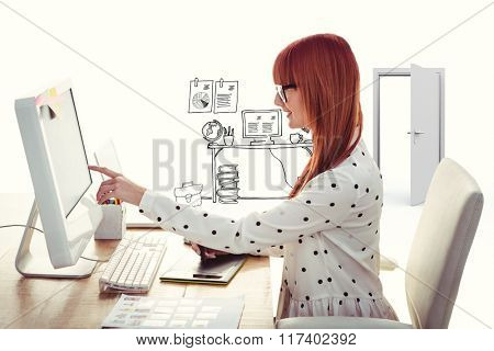 Smiling hipster woman using graphics tablet and pointing screen against doodle office with door