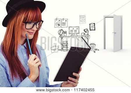 Smiling hipster woman writing notes against doodle office with door