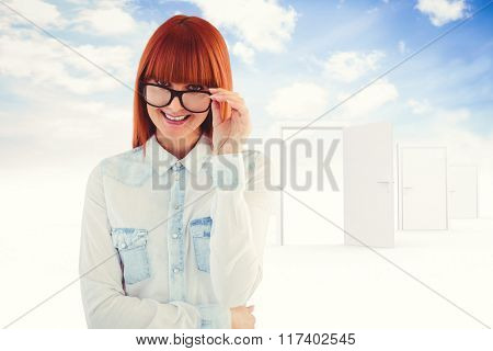 Portrait of a hipster woman front of post-it against opening door in sky