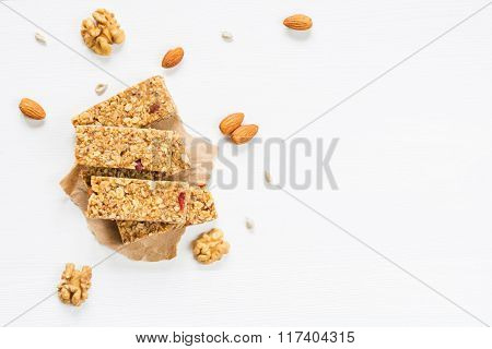 Granola bars with dried fruits and nuts on white background. Top voe