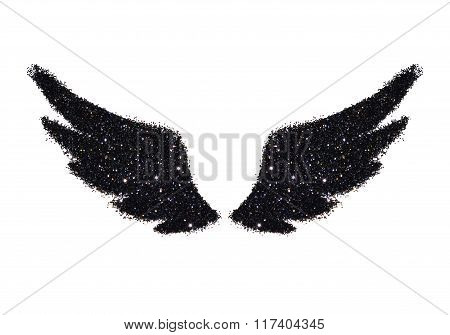 Abstract wings of black glitter on white background