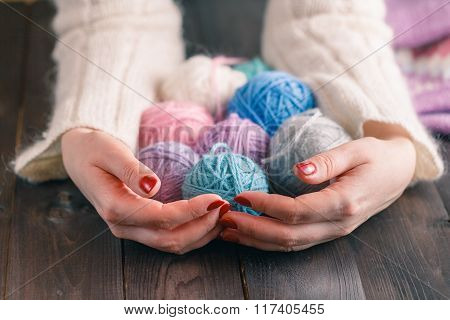 Yarn For Knitting In The Hands Of Women