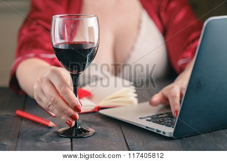 Woman Chatting On Social Networking Sites Using Laptop