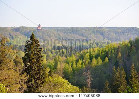 Aerial view of Gauja river valley and green forest hills in spring
