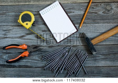 Different Tools With Blank Notebook On Wooden Background.