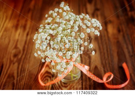 Vase With Ribbon And With Bunch Of Gypsophila Baby's-breath Flo