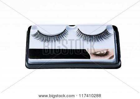 Pair of false eyelashes in a box on a white background
