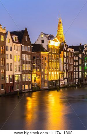 Amsterdam Canals and church at dusk Netherlands