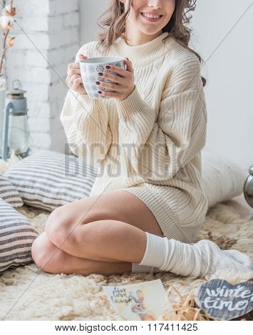 women with cup of hot chocolate