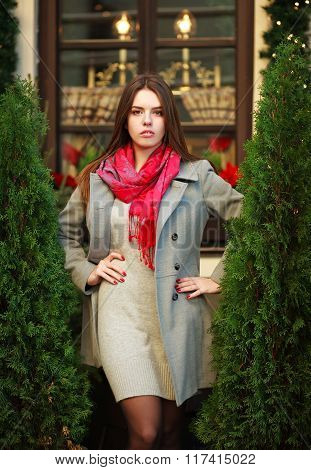 Attractive Young Fashion Woman In Coat Near The Restaurant