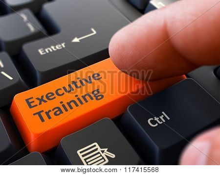 Press Button Executive Training on Black Keyboard.