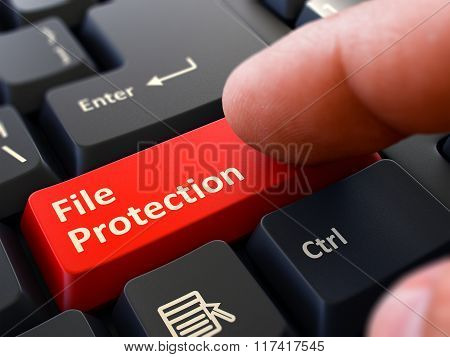 File Protection Concept. Person Click Keyboard Button.