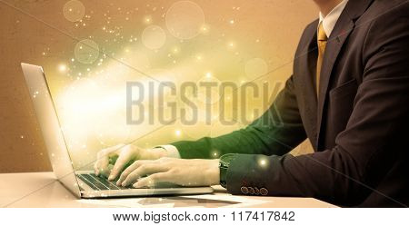 An elegant businessman sitting at desk and pushing the buttons of his laptop keyboard while working very fast illustration concept