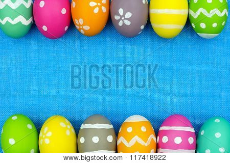 Easter egg double border over blue burlap background