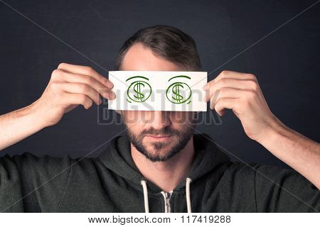 Guy holding a paper with hand drawn green dollar sign