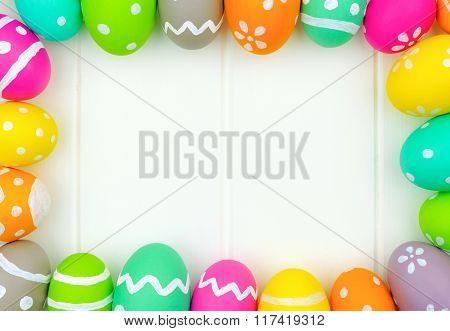 Easter egg frame over white wood