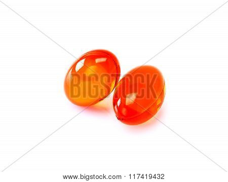 Red Supplement Capsules Isolated On White Background