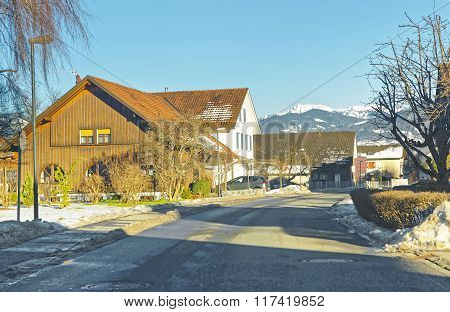 Road View Of A Swiss Village In Winter