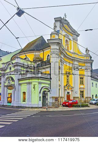 LINZ AUSTRIA - JANUARY 6 2014: Street view to a City Church in Linz of Austria
