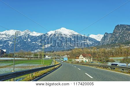 Road View On House In Snow Covered Switzerland