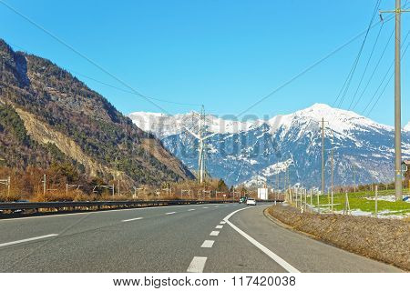 Road View On Electricity Transmission Lines In Switzerland In Winter
