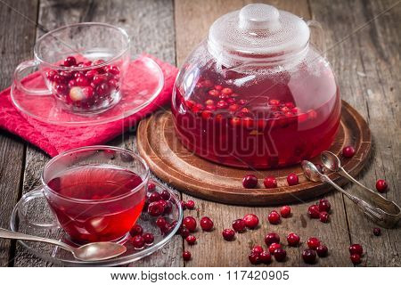 Cranberry Tea In A Glass Cup And Teapot