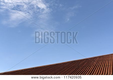Brown Roof Texture And Blue Sky.