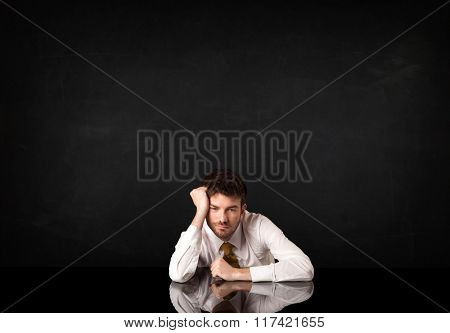 Depressed businessman sitting at a desk