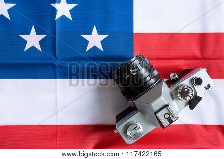 close-up American flag and retro photo camera background