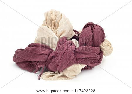 two pieces of cotton gauze of different colors entangled together, on a white background