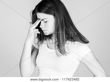 Woman With Headache Pain. Young Woman Holding Her Aching Head. Black And White