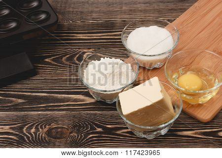 Ingredients for cooking baking on wooden table