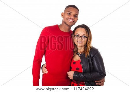 Happy Mixed Race Couple Hugging Over A White Background
